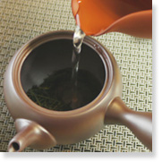 how to make green tea : poor water into the pot over the loose tea and let brew